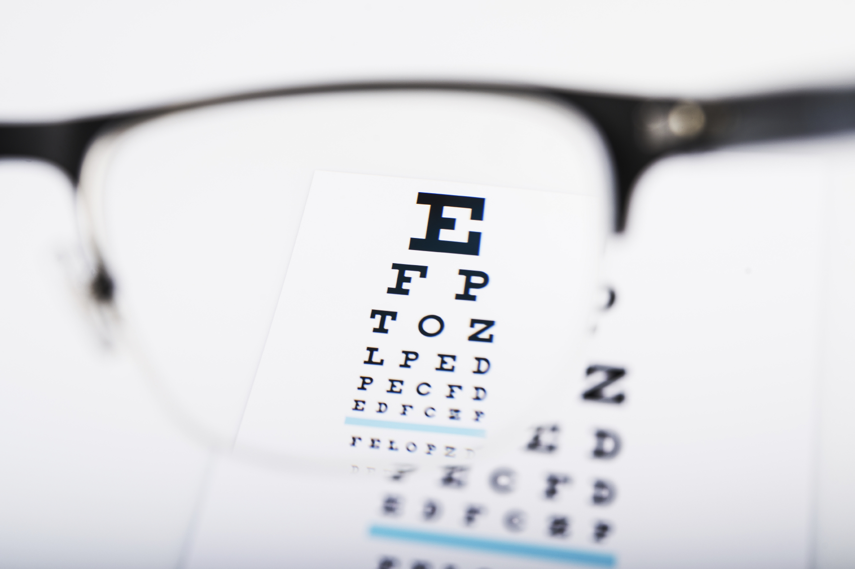 An eyesight text is clearly visible through the lens of glasses.